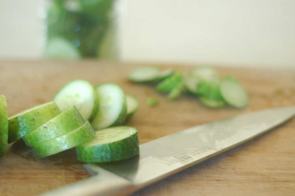 Slicing pickles for the Fermented Pickles Recipe
