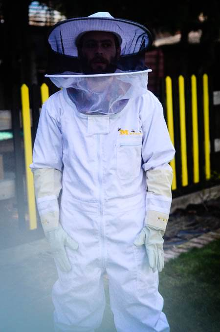 Stuart in a beekeeping hat and suit