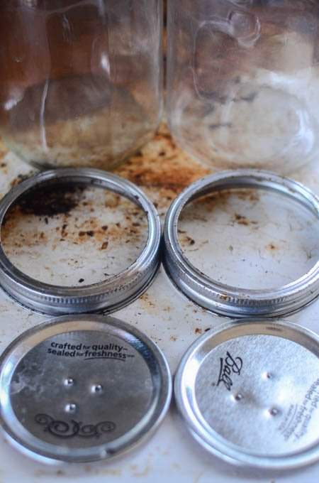 nailed Mason jar lids with rings and jars