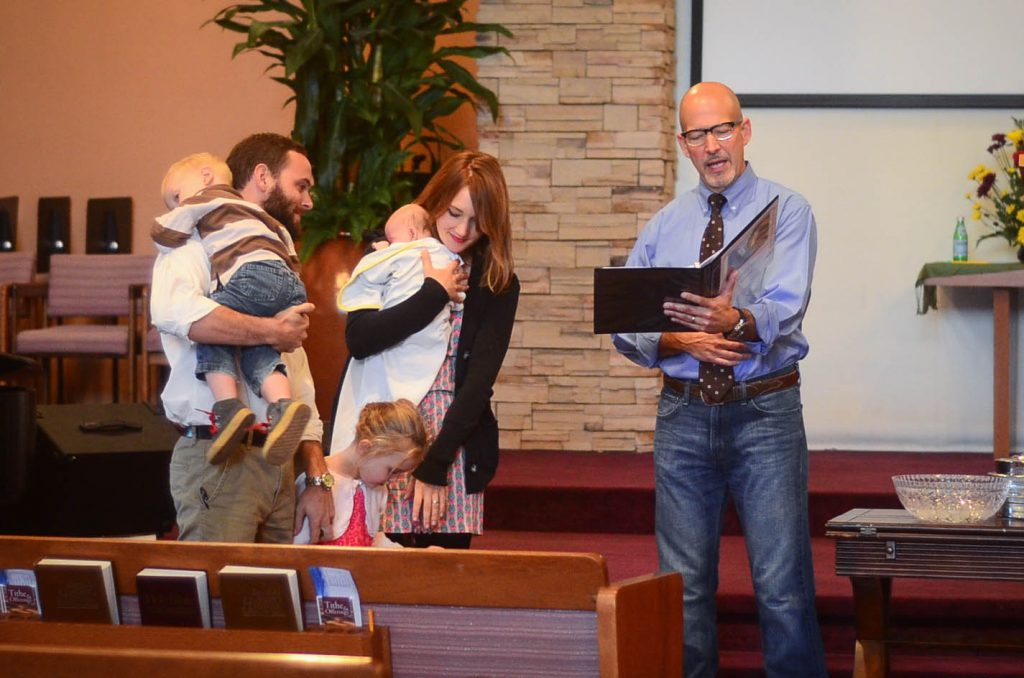 Pastor Gene reading us our baptismal vows