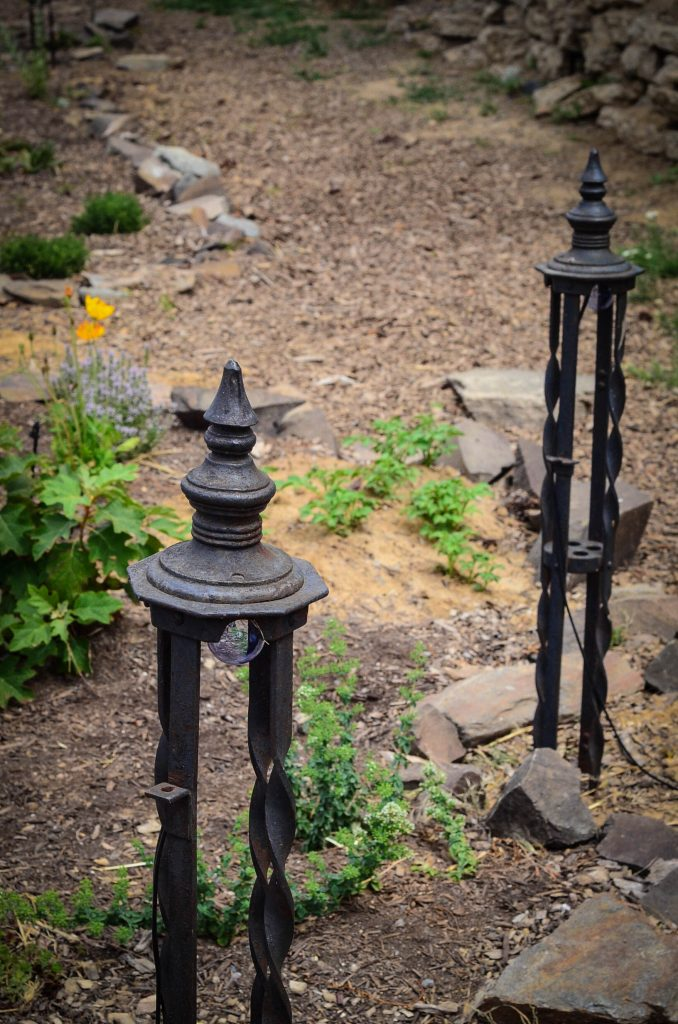 Iron fence posts, equipped with lighting.