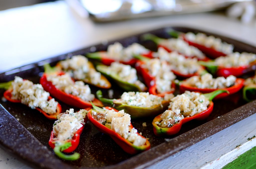 Roasted sweet peppers with goat cheese and herbs