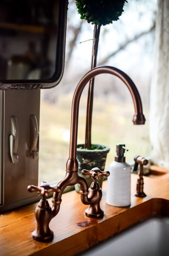 Copper faucet in our cottage kitchen | The Elliott Homestead