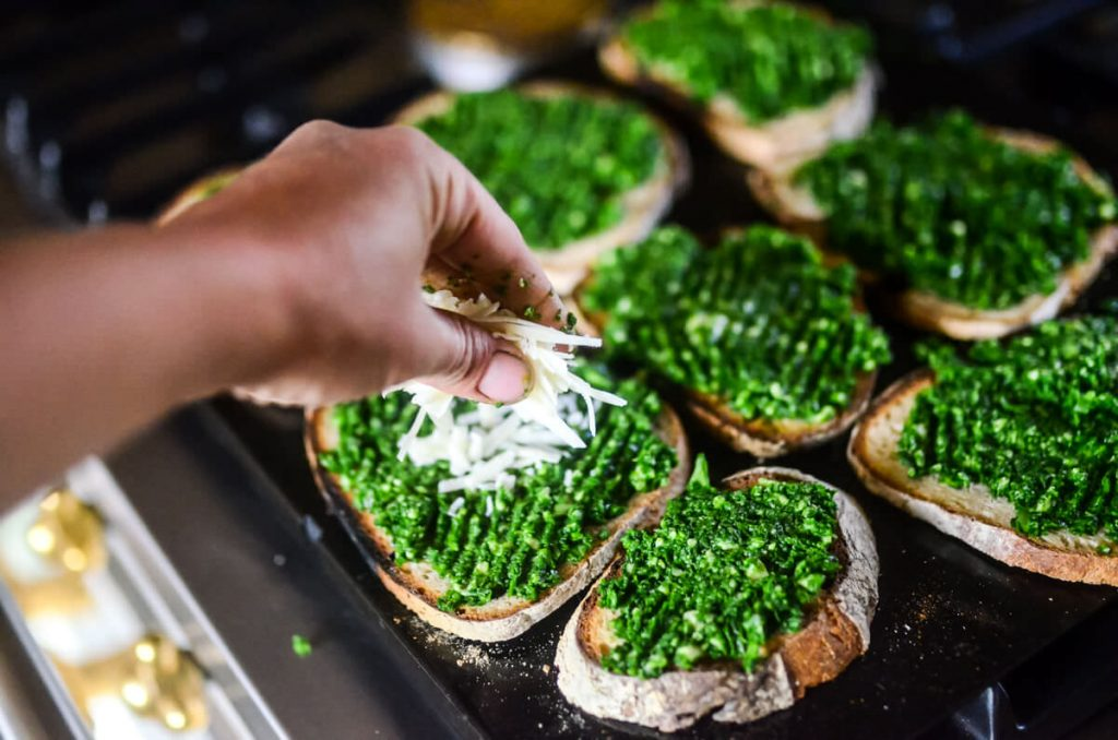 Parmesan on top of spinach toasts